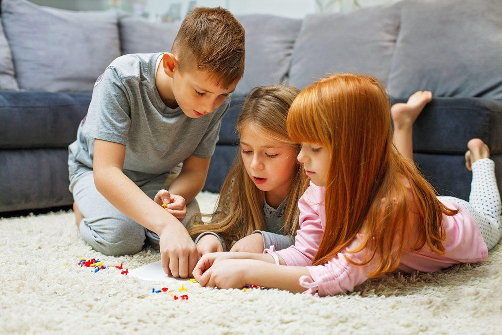 3 kids playing on floor