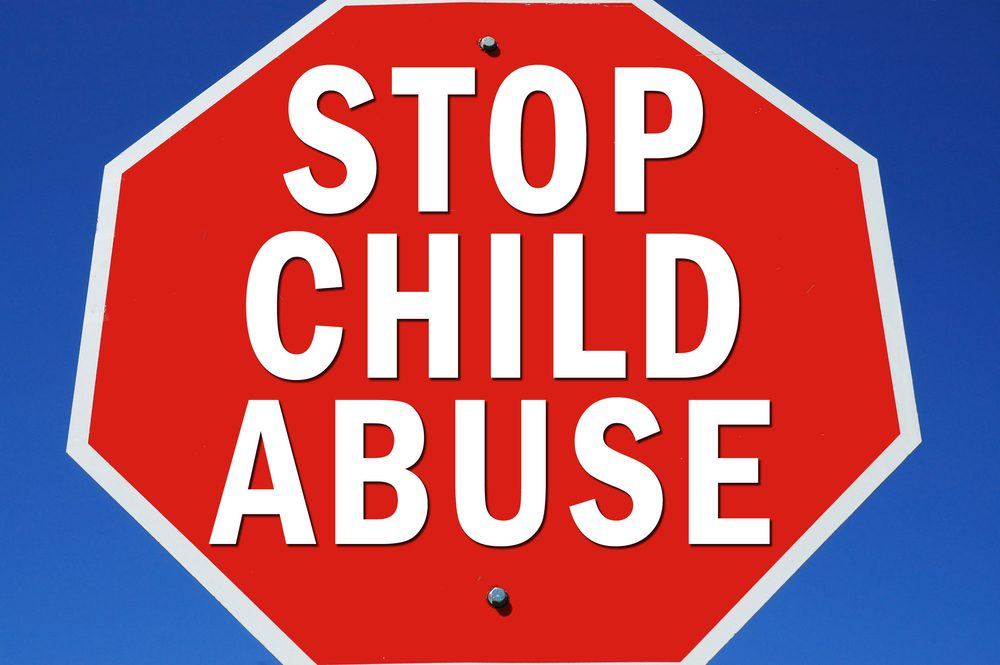 stop sign shape with words Stop Child Abuse